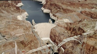 DCA04_006 - 4K stock footage aerial video flying away from Hoover Dam, Boulder City, Nevada