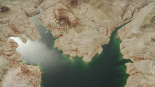 DCA04_016 - 4K stock footage aerial video of a bird's eye view of a desert shoreline of a bay on Lake Mead, Las Vegas, Nevada