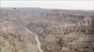 DCA04_026 - 4K stock footage aerial video of a helicopter flying over the Colorado River in Grand Canyon, Arizona