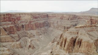 DCA04_032 - 4K stock footage aerial video of a dry riverbed in Grand Canyon, Arizona, and tilt to steep cliffs