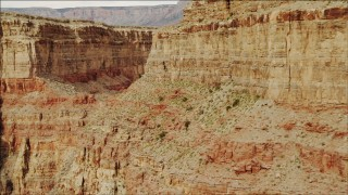 DCA04_038 - 4K stock footage aerial video of passing a sheer cliff in Grand Canyon, Arizona