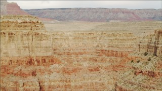 DCA04_039 - 4K stock footage aerial video of flying by jagged cliffs in Grand Canyon, Arizona