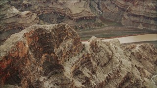 DCA04_043 - 4K stock footage aerial video of flying over a rock formation near the Colorado River in Grand Canyon, Arizona