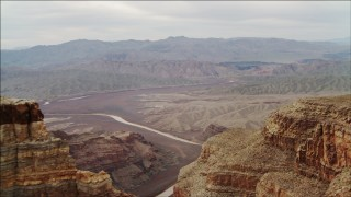 DCA04_048 - 4K stock footage aerial video of flying around a rock formation in Grand Canyon, revealing Colorado River, Arizona