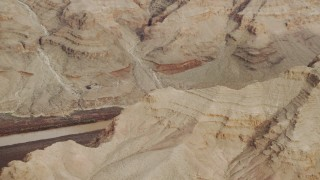 DCA04_056 - 4K stock footage aerial video of panning across rock formations in Grand Canyon, revealing Colorado River, Arizona
