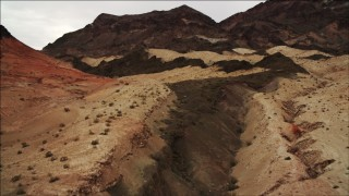 DCA04_069 - 4K stock footage aerial video of flying over desert dunes near Hiller Mountains, Nevada