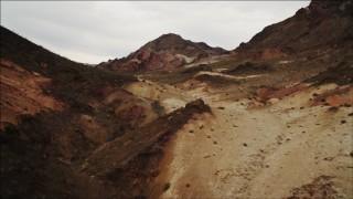 DCA04_070 - 4K stock footage aerial video of flying over desert dunes toward Hiller Mountains, Nevada
