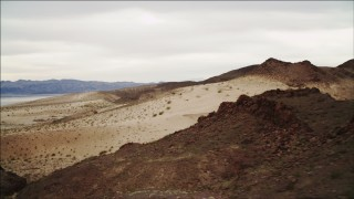 DCA04_088 - 4K stock footage aerial video of flying over sandy dunes near Lake Mead, Nevada
