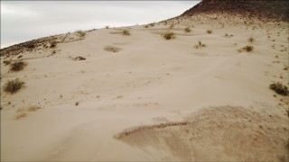 DCA04_089 - 4K stock footage aerial video of flying over sandy dunes near Lake Mead, Nevada