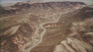 DCA04_095 - 4K stock footage aerial video of following a winding road in the Nevada Desert, Nevada