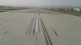 DCA05_001 - 4K stock footage aerial video of taxiing onto Van Nuys Airport runway, accelerating, Van Nuys, California