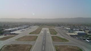 DCA05_002 - 4K stock footage aerial video of lifting off from Van Nuys Airport runway, Van Nuys, California