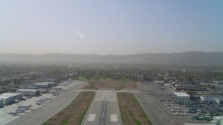 DCA05_003 - 4K stock footage aerial video of ascending over runway Van Nuys Airport; Van Nuys, California