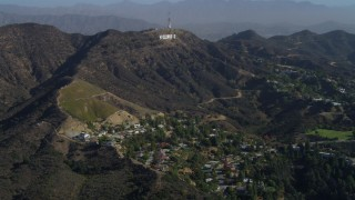 DCA05_004 - 4K stock footage aerial video of flying over Hollywood Hills, approaching Hollywood Sign, Los Angeles, California