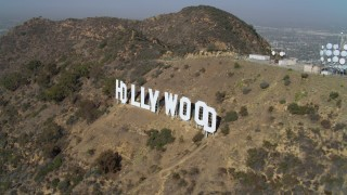 DCA05_007 - 4K stock footage aerial video of orbiting the Hollywood Sign, Los Angeles, California