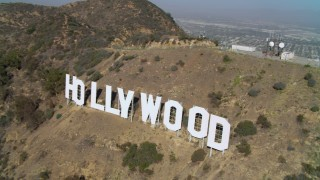 DCA05_008 - 4K stock footage aerial video of hovering near and then orbiting the Hollywood Sign, Los Angeles, California