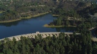 DCA05_020 - 4K stock footage aerial video of flying over Mulholland Dam, Hollywood Reservoir, Los Angeles, California