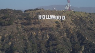 DCA05_021 - 4K stock footage aerial video tilt from the Hollywood Reservoir, revealing Hollywood Sign, Los Angeles, California