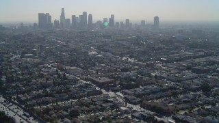 DCA05_023 - 4K stock footage aerial video of flying over Highway 101, revealing Downtown skyline, Los Angeles, California