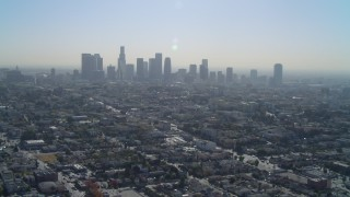 DCA05_024 - 4K stock footage aerial video of approaching the Downtown skyline, Los Angeles, California