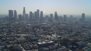 DCA05_025 - 4K stock footage aerial video of approaching the Downtown skyline, Los Angeles, California
