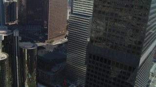 DCA05_036 - 4K stock footage aerial video of Paul Hastings Tower, Los Angeles Public Library, Downtown Los Angeles, California