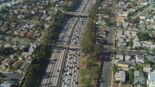 DCA05_057 - 4K stock footage aerial video of following Interstate 10 through Pico-Union,tilt down, Los Angeles, California
