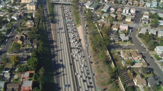 DCA05_058 - 4K stock footage aerial video of heavy traffic on Interstate 10 through Pico-Union, Los Angeles, California