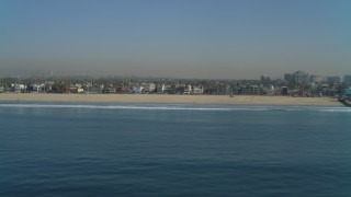 DCA05_075 - 4K stock footage aerial video of the beach seen from ocean, reveal Venice Fishing Pier, Venice, California