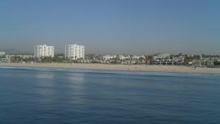 DCA05_078 - 4K stock footage aerial video of flying by Santa Monica State Beach, beachfront apartments, Santa Monica, California