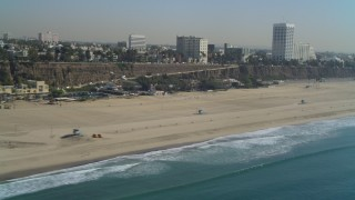 DCA05_094 - 4K aerial stock footage video of flying by Santa Monica State Beach. Santa Monica, California
