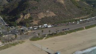 DCA05_097 - 4K stock footage aerial video of flying by Highway 1 near the coast, Pacific Palisades, California