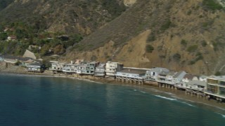 DCA05_103 - 4K stock footage aerial video of flying by beachfront homes, Highway 1 along the coast, Malibu, California