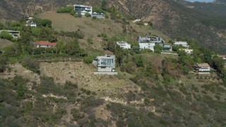DCA05_113 - 4K stock footage aerial video of approaching a home in the Malibu hills, Malibu, California