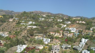 DCA05_116 - 4K stock footage aerial video of flying by hillside homes, Malibu, California