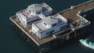 DCA05_120 - 4K stock footage aerial video of flying over Malibu Pier, and tilt to a bird's eye view, Malibu, California