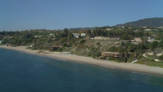 DCA05_127 - 4K stock footage aerial video of flying by coastal homes, Malibu, California