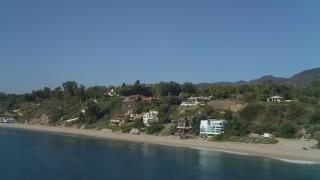 DCA05_128 - 4K stock footage aerial video of flying by coastal homes, Malibu, California