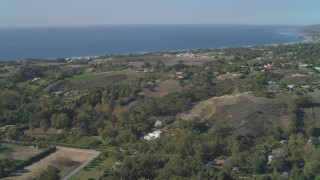 DCA05_132 - 4K stock footage aerial video of flying by residential neighborhoods, view of the ocean, Malibu, California