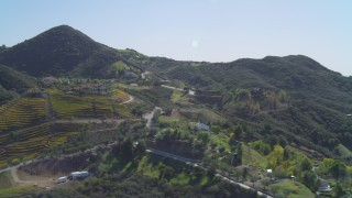 DCA05_136 - 4K stock footage aerial video of flying by homes and vineyards in the hills, Malibu, California