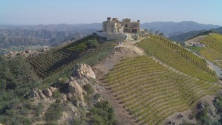 DCA05_138 - 4K stock footage aerial video of orbiting winery, vineyards on a hill, Malibu, California