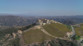DCA05_139 - 4K stock footage aerial video of orbiting a winery and vineyard on a hill, Malibu, California