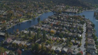 DCA05_144 - 4K stock footage aerial video pan across homes, Westlake Lake, reveal mountains, Westlake Village, California