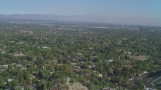 DCA05_156 - 4K stock footage aerial video of flying over Hidden Hills, approaching San Fernando Valley, California