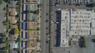 DCA05_161 - 4K stock footage aerial video of a bird's eye of residential neighborhoods, reveal Fallbrook Center, West Hills, California