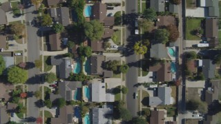 DCA05_163 - 4K stock footage aerial video of a bird's eye view over neighborhoods, church, Canoga Park, California