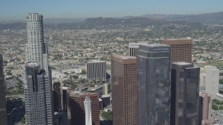 DCA06_013 - 4K stock footage aerial video of flying by city skyscrapers in Downtown Los Angeles, California