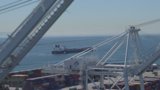 DCA06_030 - 4K stock footage aerial video of an oil tanker seen from cargo cranes at Port of Long Beach, California