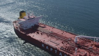 DCA06_033 - 4K stock footage aerial video fly over oil tanker sailing the ocean near Long Beach, California
