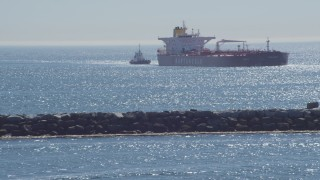 DCA06_035 - 4K stock footage aerial video of an oil tanker and tugboat near breakwater, Long Beach, California